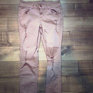 Pink destructed skinny jeans